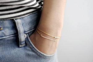 model with dainty gold bracelets set