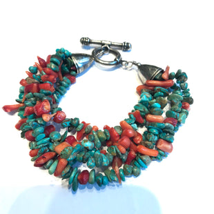 Multi row turquoise and spiny bracelet