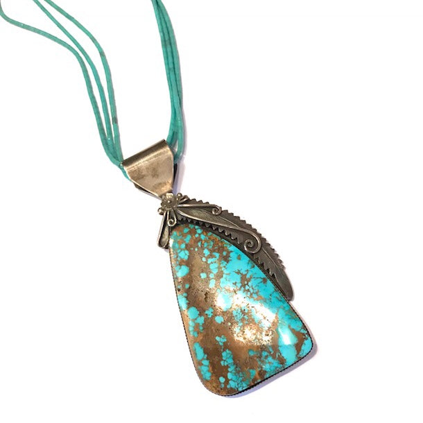 large turquoise pendant with petrified wood