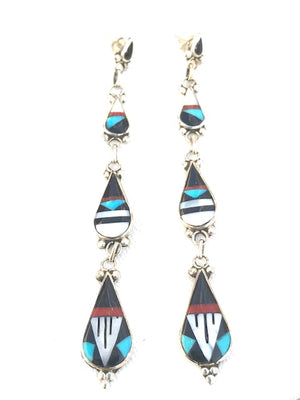 Inlaid stone earrings made by Zuni artist