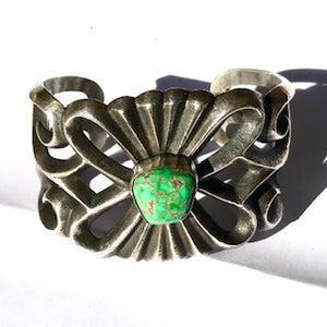Sandcast  bracelet with rare green turquoise