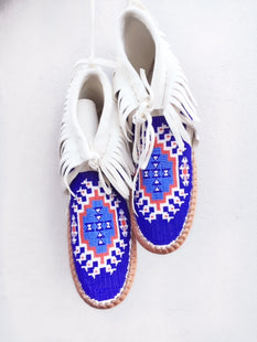 bright blue, white and red moccasins.