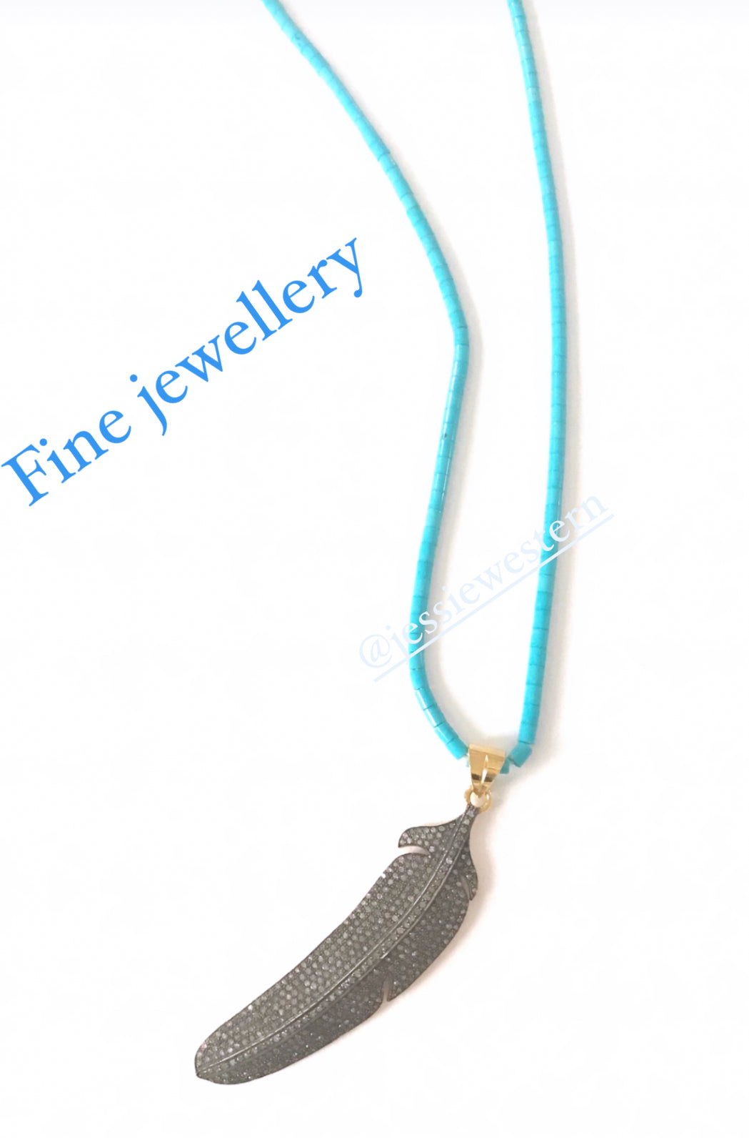 Diamond feather pendent