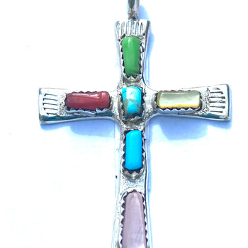 Cross pendent inlaid with stones