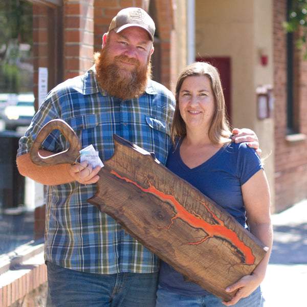 Image of Danny and Tina garner in front of Grass Valley Brewing with one of their charcuterie boards