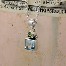 Load image into Gallery viewer, Forget-Me-Not Blue Topaz & Peridot Silver Pendant