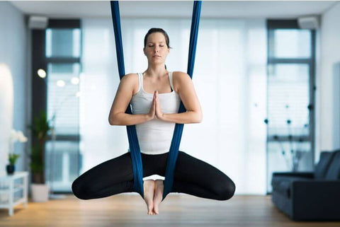 Everything You Need To Know About How To Perform Aerial Yoga At Home