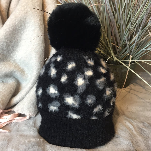 FLUFFY ANIMAL PRINT POM POM HAT IN BLACK
