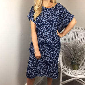 KNOT BACK COCOON DRESS IN NAVY