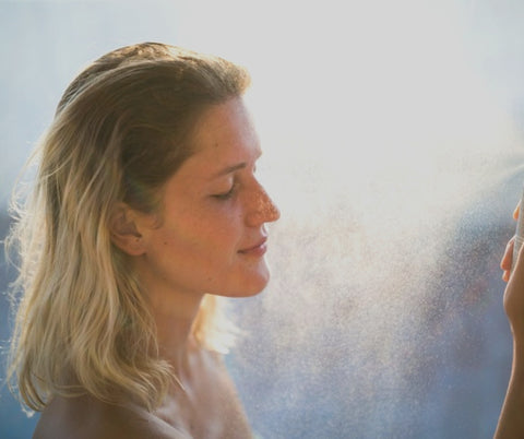 woman spraying mist