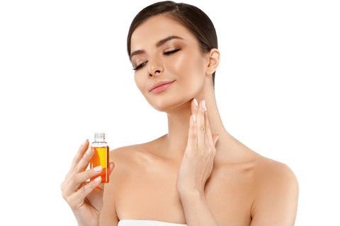 woman applying face oil