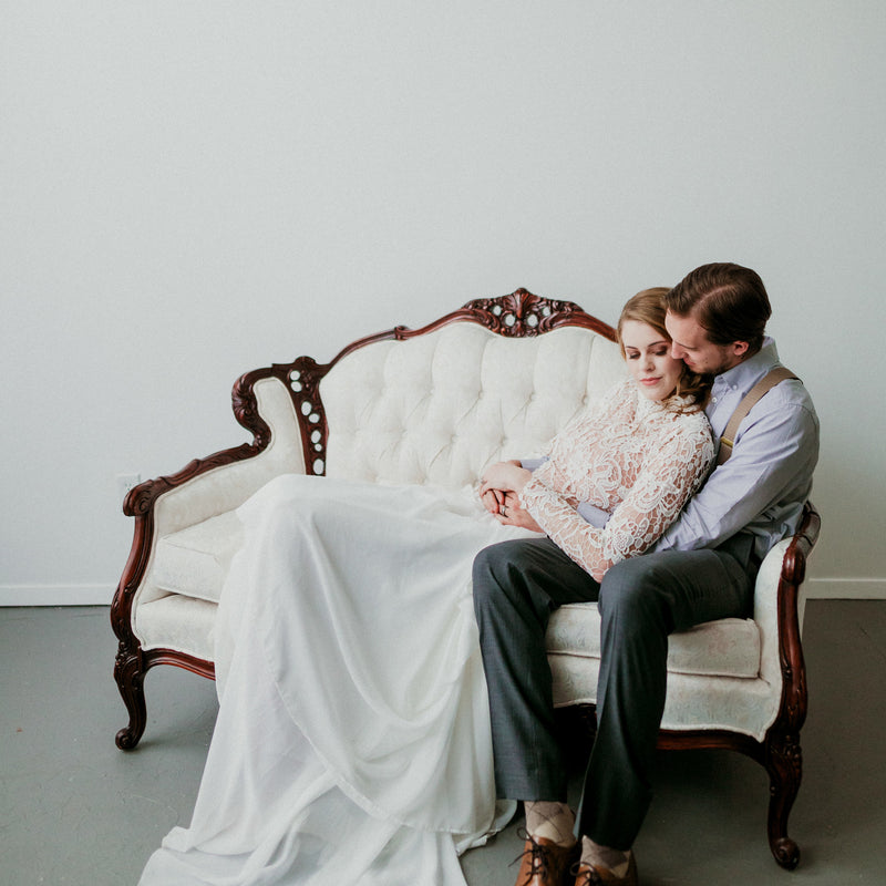 Bridal shoot on a white vintage love seat