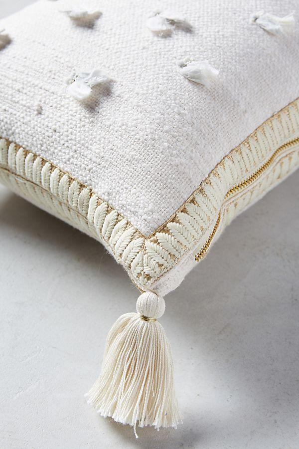 decorative pillow with cream and gold tassels