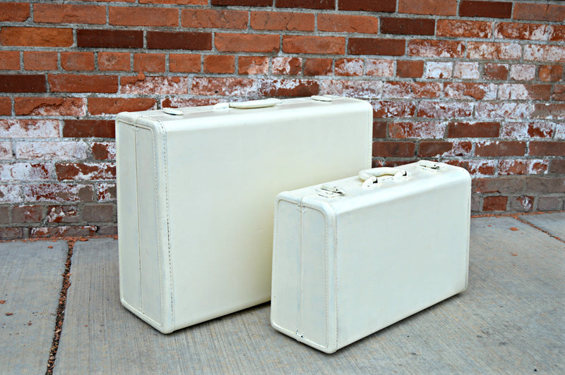 Cream vintage suitcases, prop decor