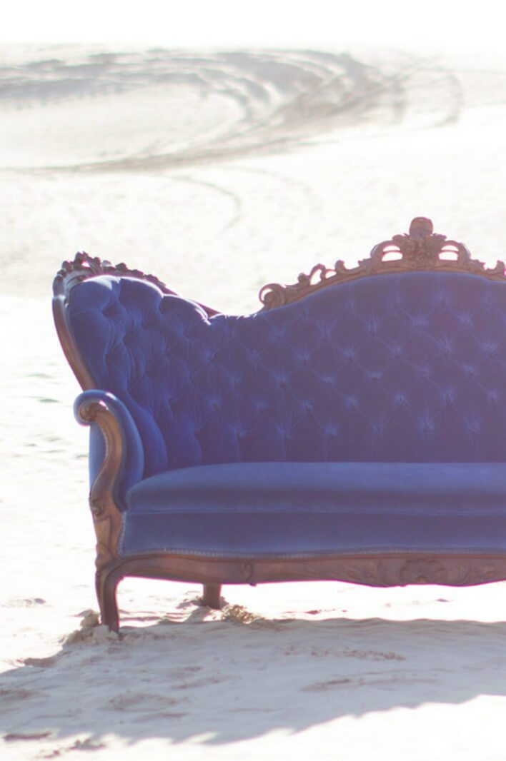 Blue Victorian settee in the desert
