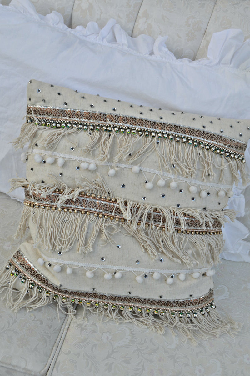 Boho cream pillow with fringe, sequins, and pom-poms