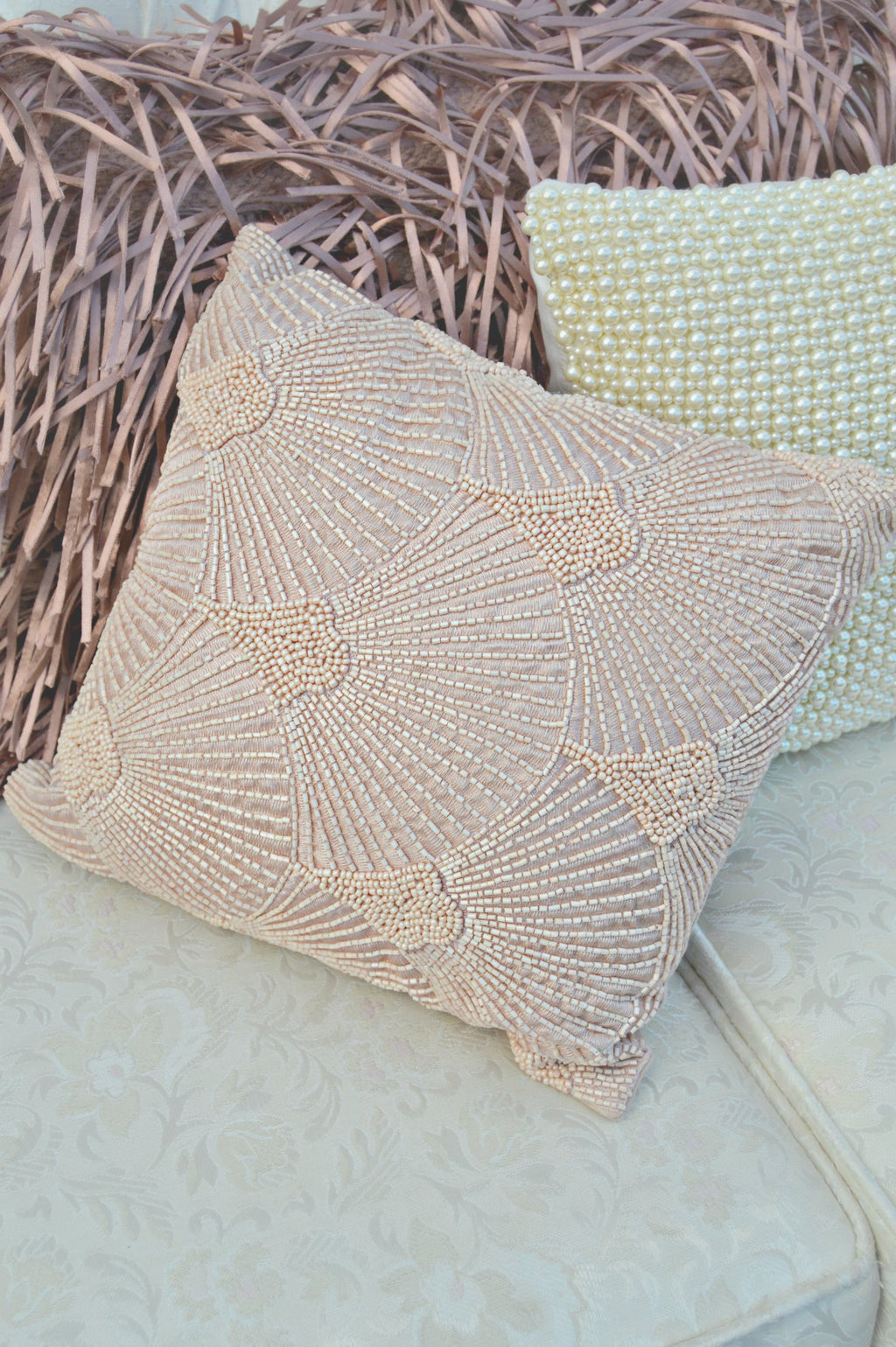 Pink beaded embellished pillow