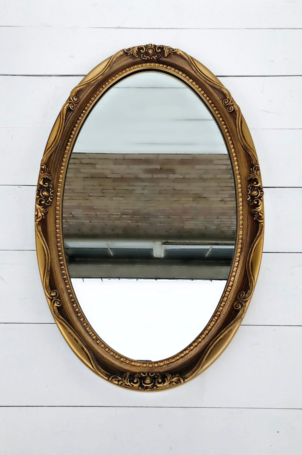 Oval vintage gold mirror