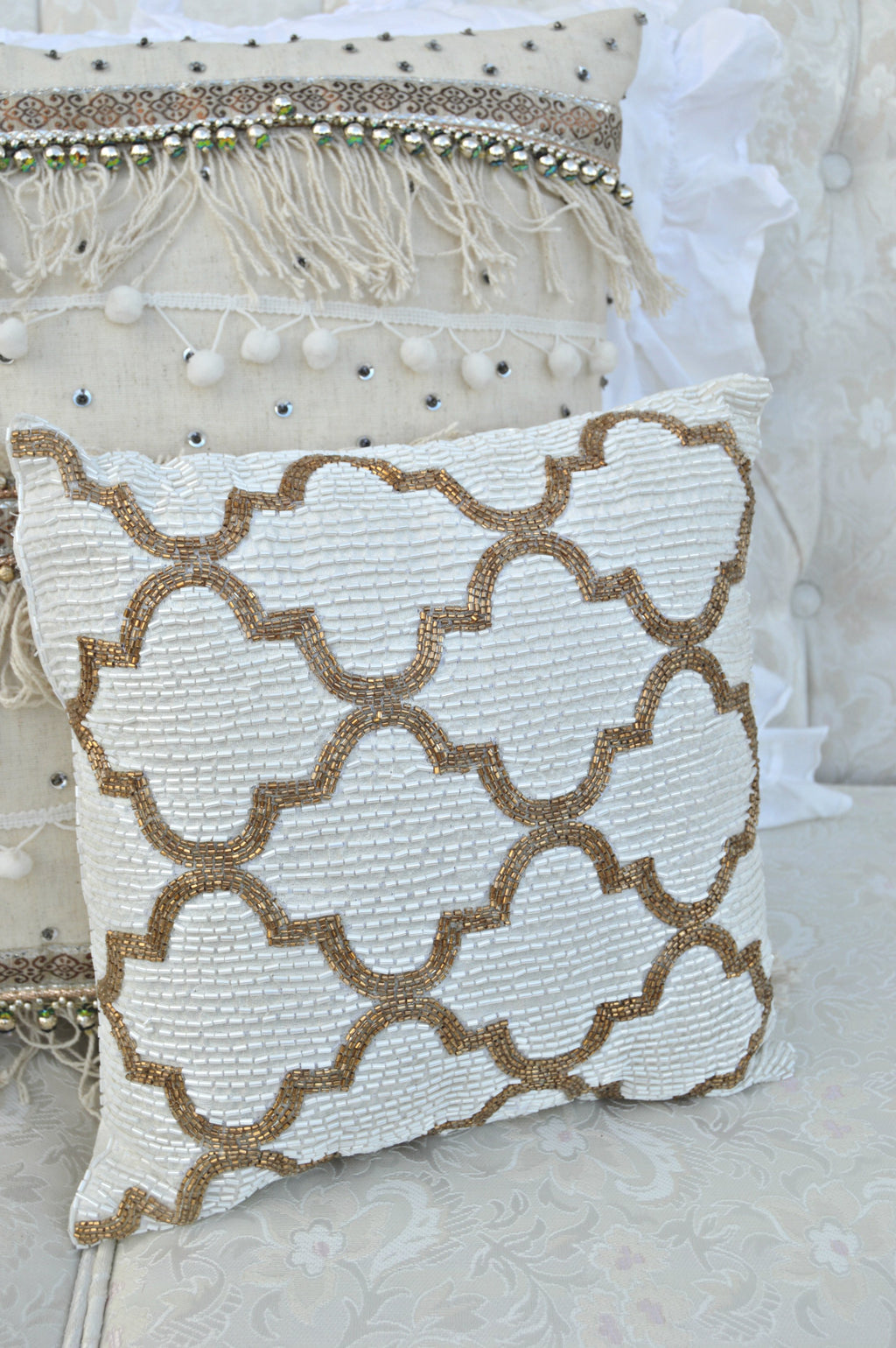 Bronze and ivory beaded pillow