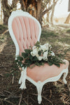 Pink velvet wing-back chairs
