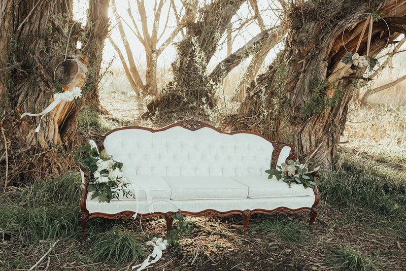 Elegant ivory vintage sofa outdoors