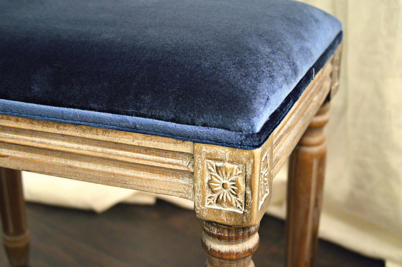 Details on blue velvet bench