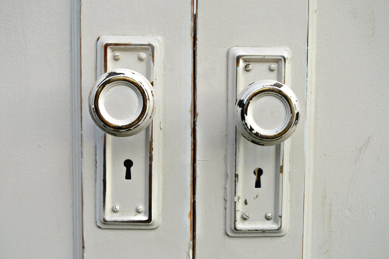 Antique white doors and doorknobs