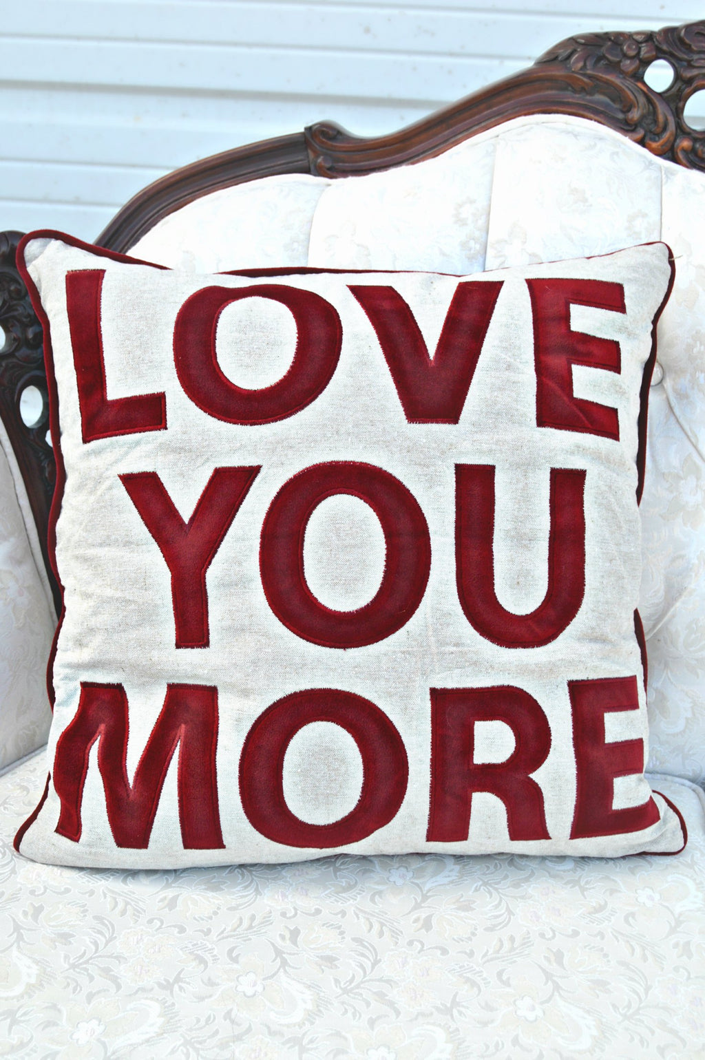 Love you more pillow with red letters