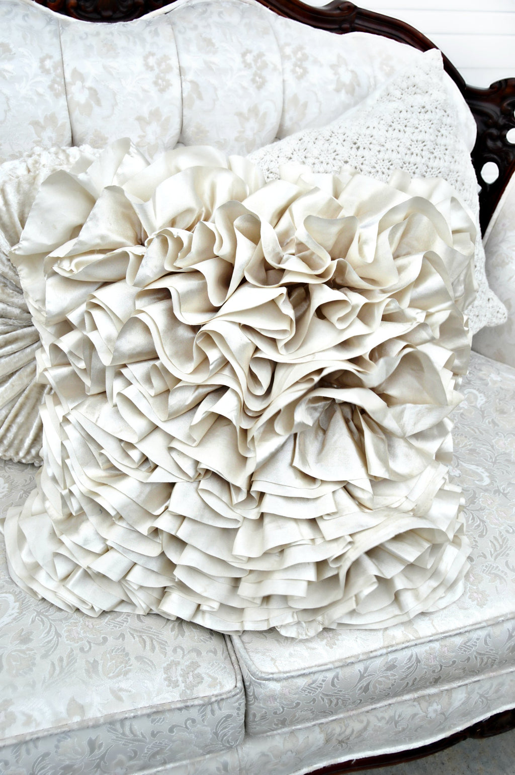 Ivory ruffled decorative pillow