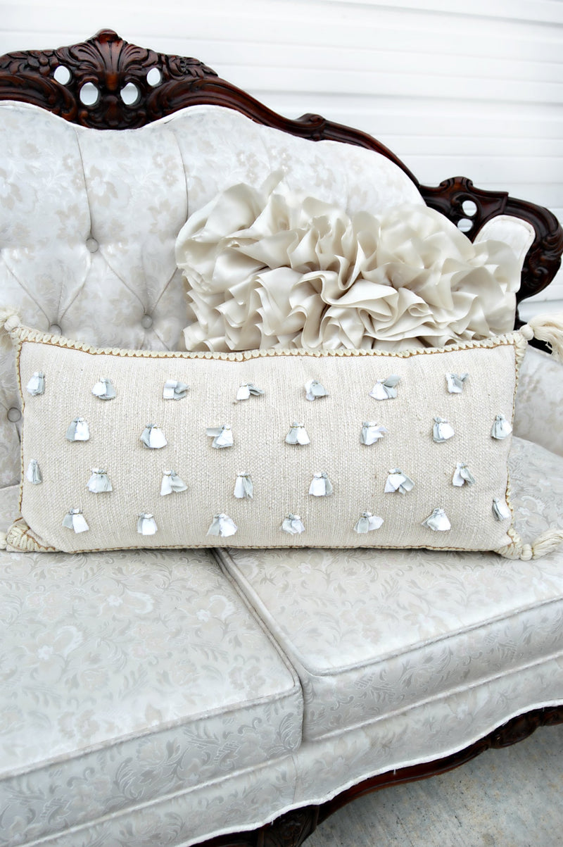 Cream decorative pillow with grey and gold details
