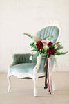 Blue velvet wing back chair with florals