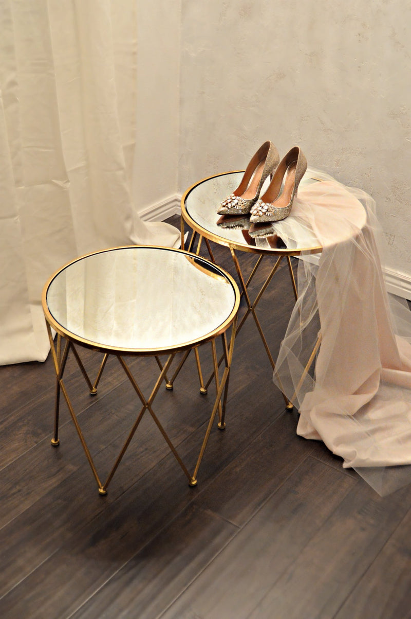 Gold mirror nesting tables