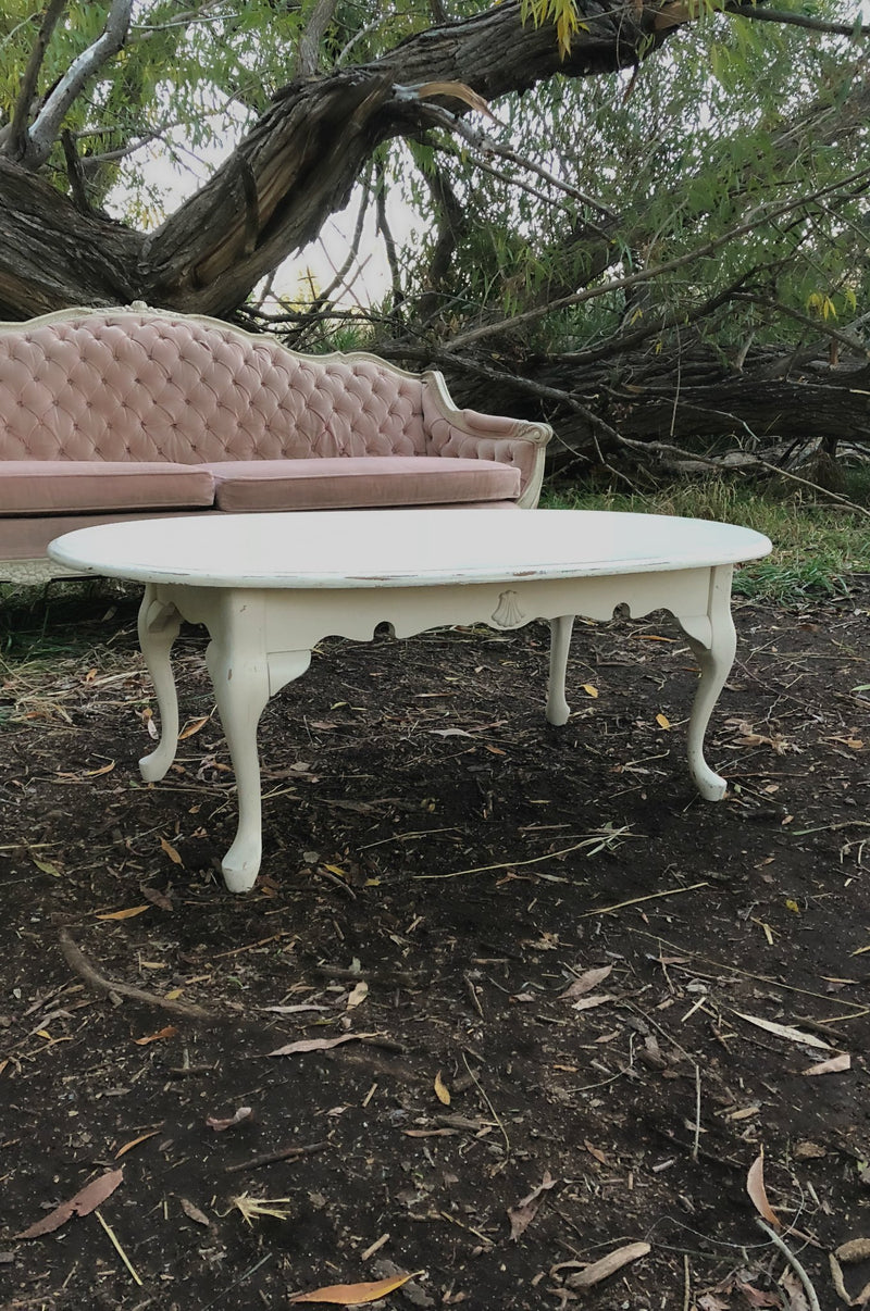 Cream coffee table with pink sofa