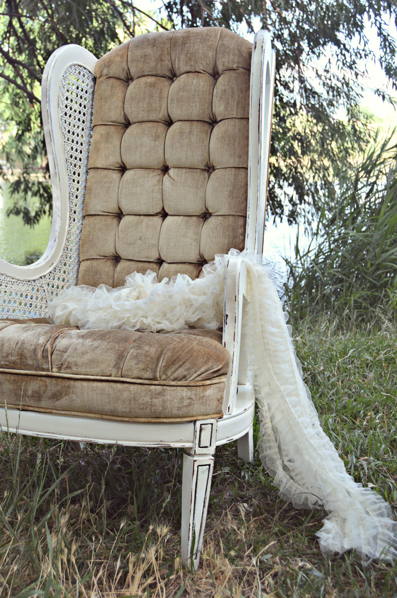 Vintage tan wing-back chair