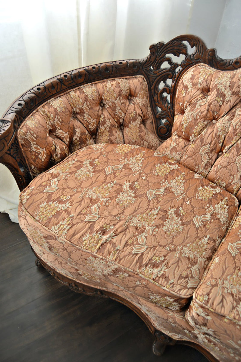 Fabric of rust colored Victorian sofa