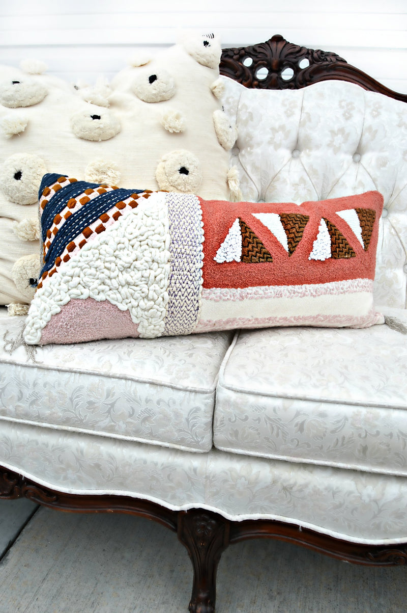 Multi colored geometric print pillow