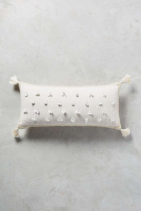 Cream decorative pillow with blue and gold details