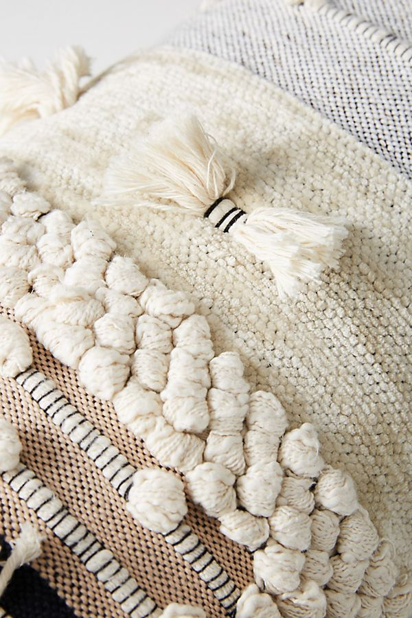 Boho pillow with pom poms