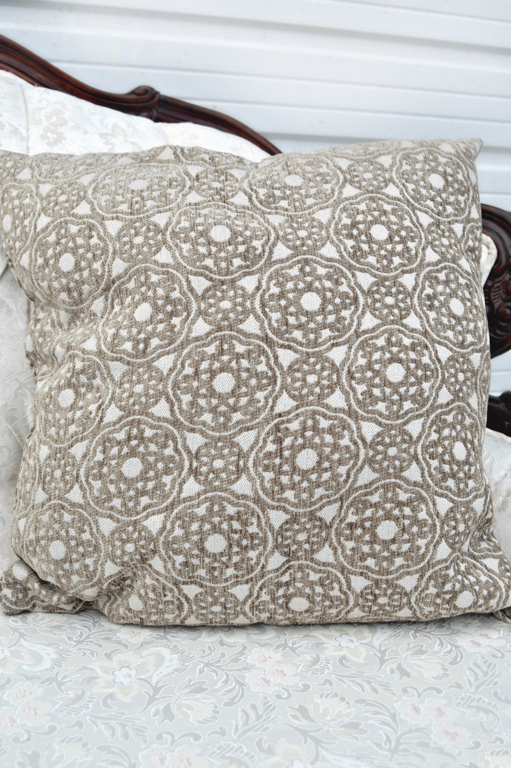 Tan kaleidoscope patterned pillow