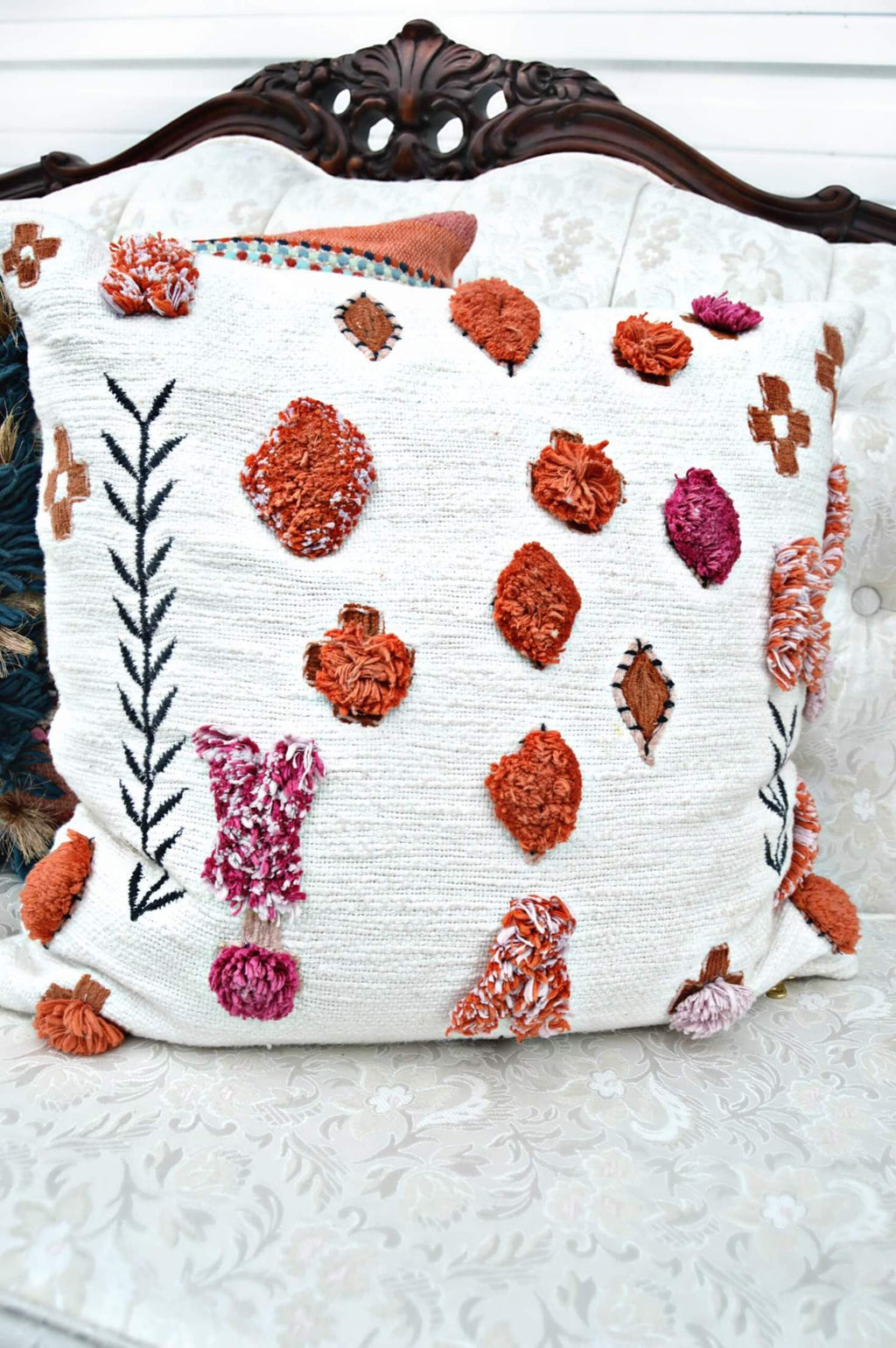 Bohemian throw pillow with pink and orange poms