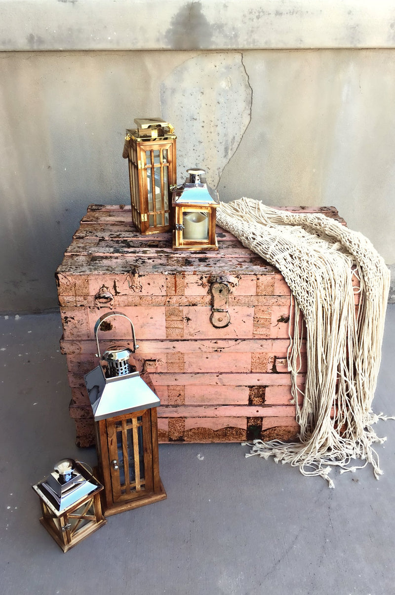 Antique pink trunk and lanterns