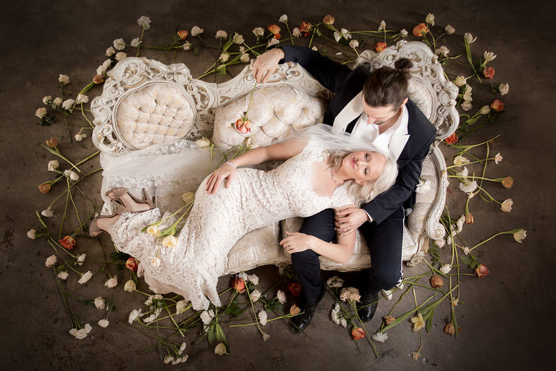 Bride and Groom lounging on beautiful Victorian settee