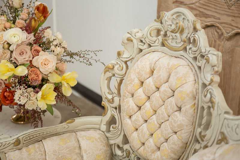 Tufts on cream and gold vintage settee