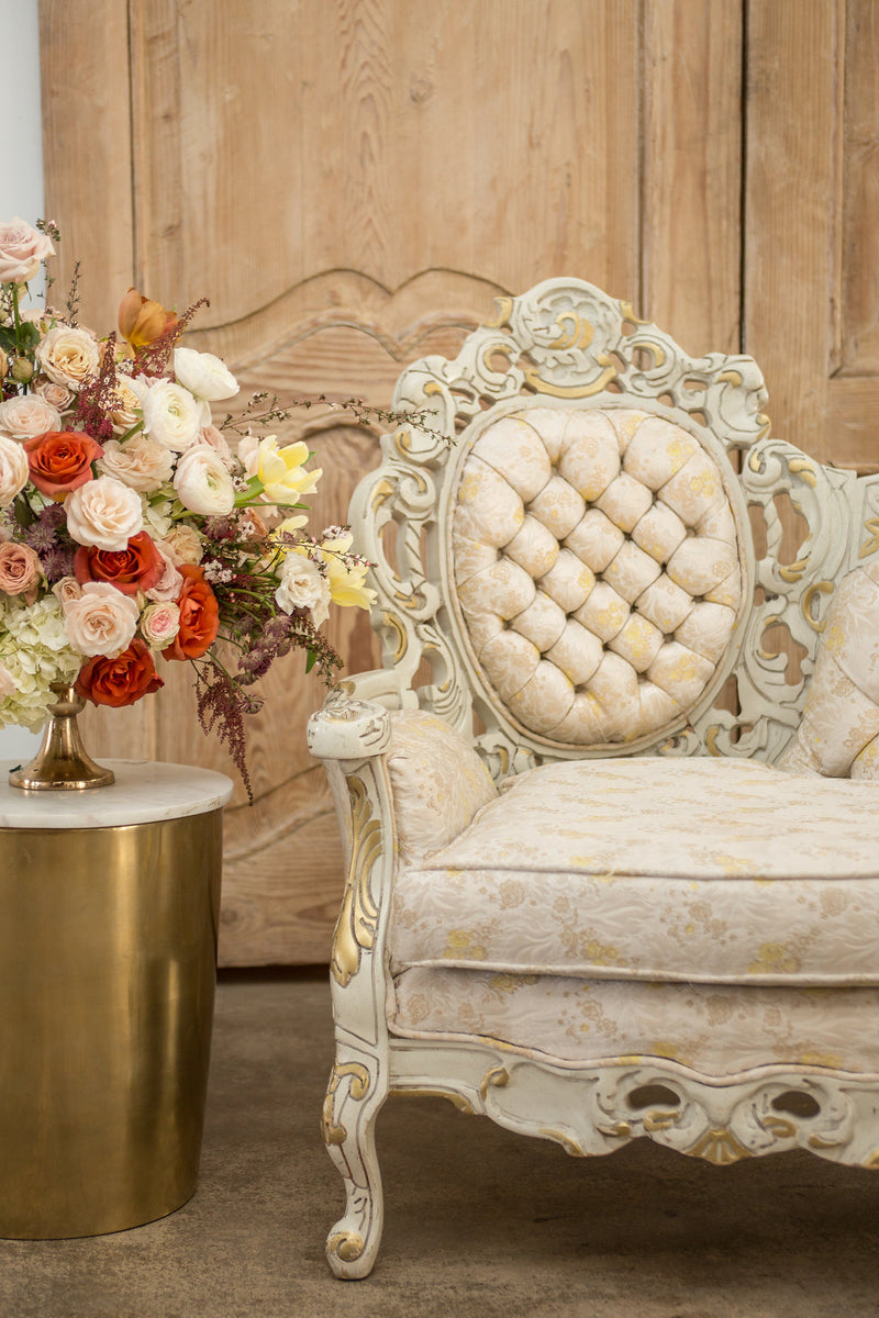 Rococo details on cream and gold vintage settee