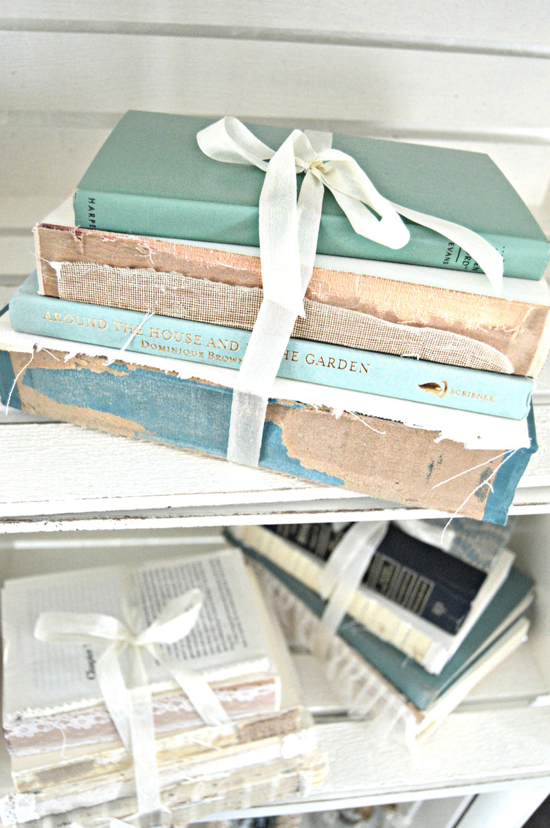 Blue vintage books bundled together for wedding centerpieces