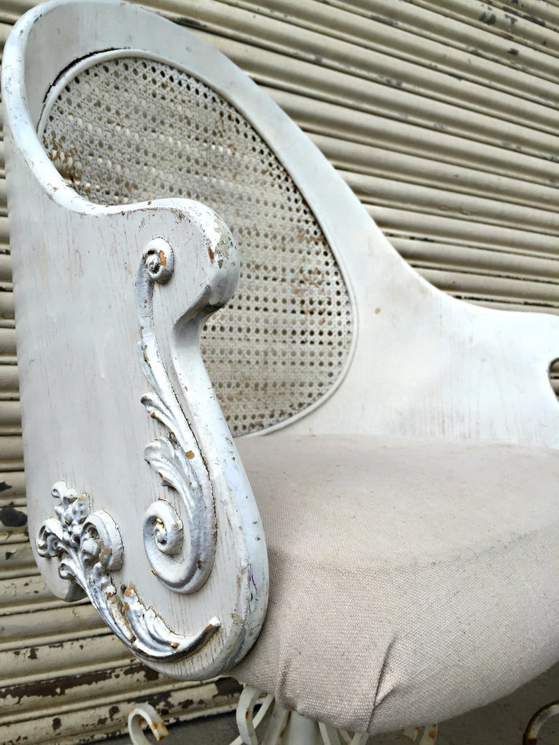 White detailed upholstered chair
