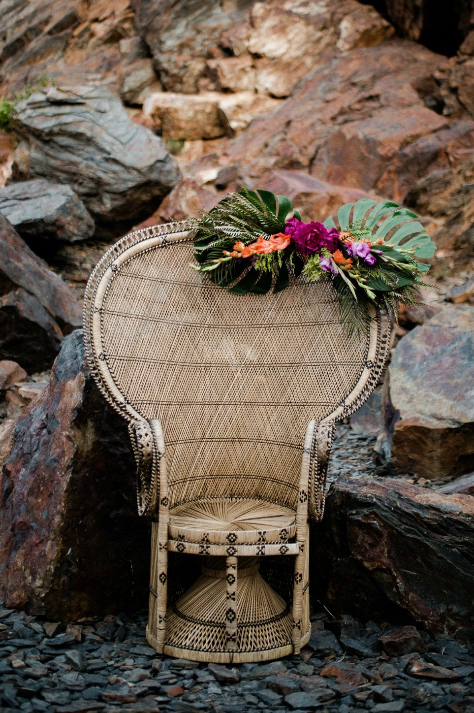 Peacock chair with floral decor in mountains