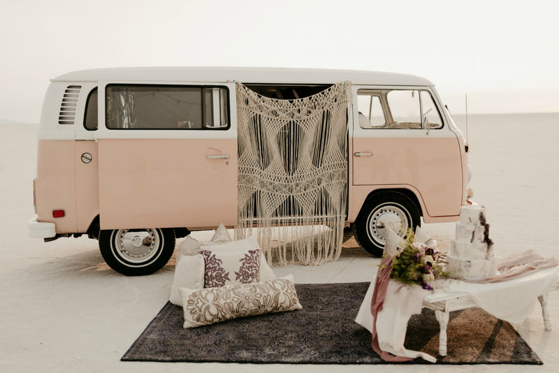 VW bus with macrame and bohemian decor in the desert