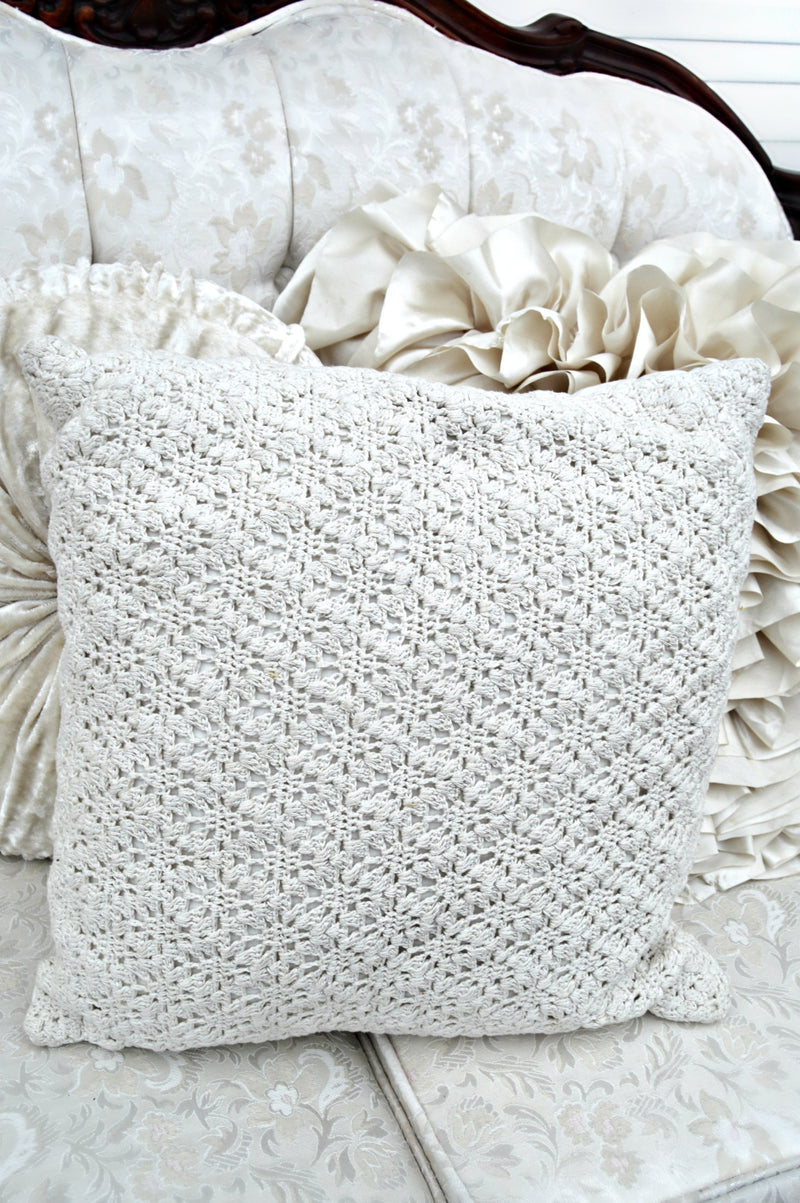 Cream crochet pillow