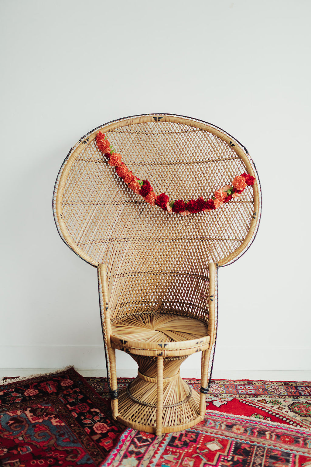 Peacock chair with floral decor